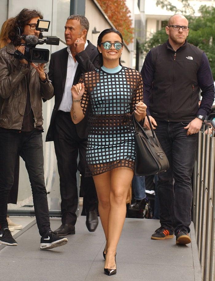 Paparazzi trail Demi Lovato as she struts through Paris in a two-piece ensemble from Vesace