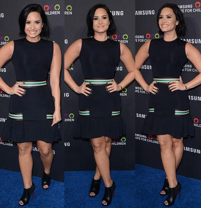 Demi-Lovato-sleeveless-flared-LBD-black-booties