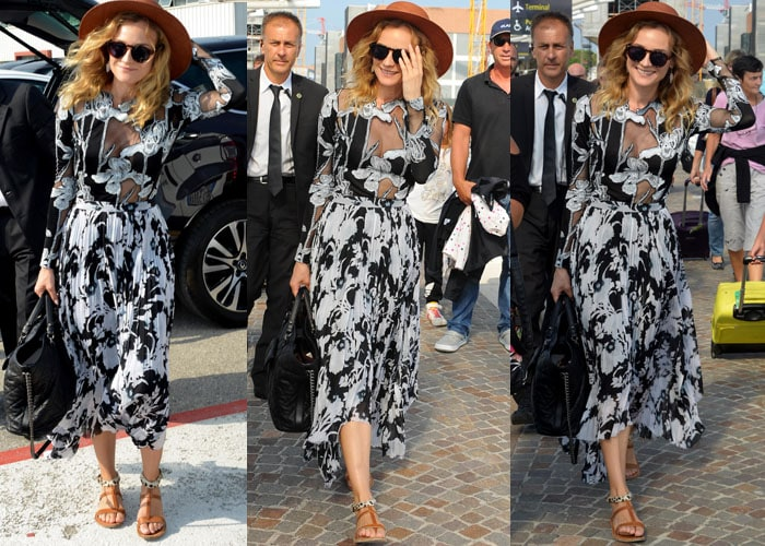 Diane Kruger makes her entrance into Italy wearing a black-and-white print Thakoon maxi dress