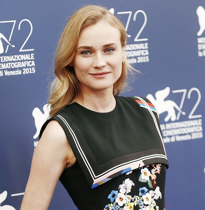 Diane Kruger smiles in a sleeveless dress with a nautical-inspired panel at the yoke and floral threadwork embroidery
