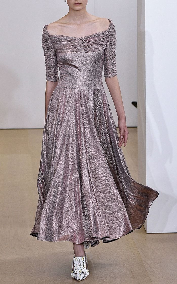 Emilia Wickstead's 'Nicoletta' metallic dress has a ruched top, fitted bodice, off-the-shoulder sleeves and long skirt
