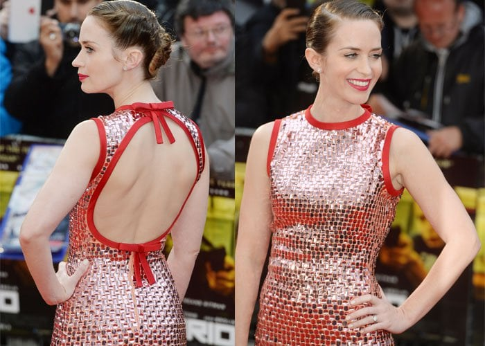 Emily Blunt shows off her styled hair and the open back on her Prada dress