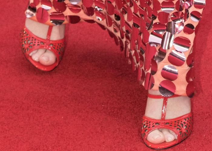 Emily Blunt shows off her sexy feet in Paul Andrew heels