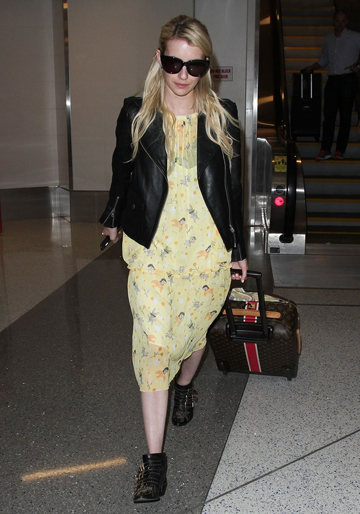 Emma-Roberts-arrives-at-LAX-from-New-Orleans