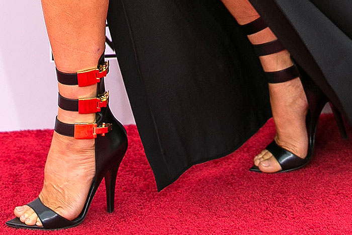 Fergie struts the red carpet in a pair of Versus x Anthony Vaccarello triple-clasp sandals