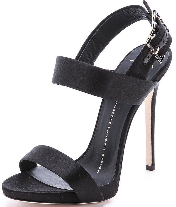 A sparkling, crystal-trimmed buckle gives these satin Giuseppe Zanotti sandals a pop of gothic glamour