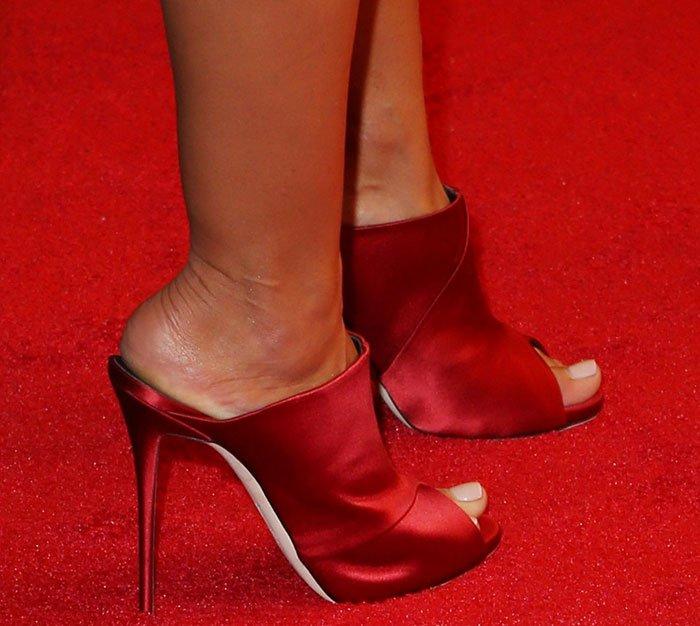 Heidi Klum wears a pair of Giuseppe Zanotti mule sandals