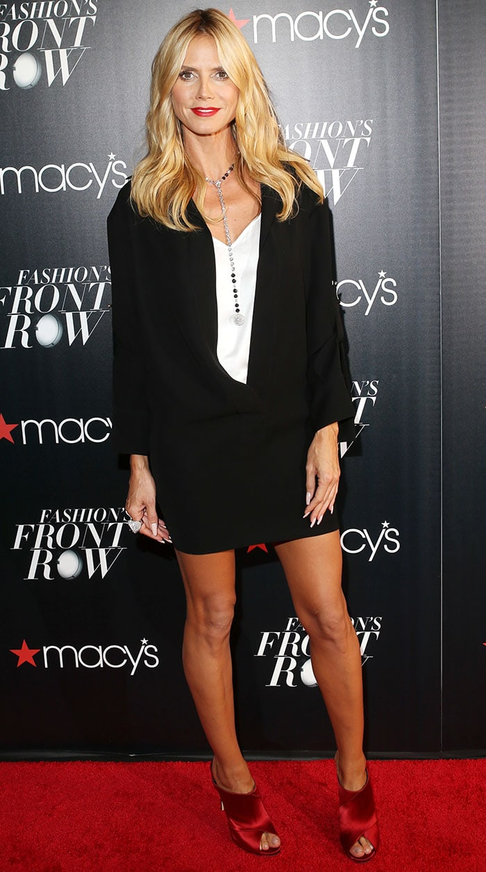 Heidi Klum exudes confidence as she poses on the red carpet in a black-and-white ensemble