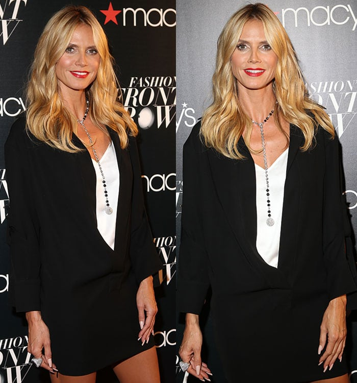 Heidi Klum completes her monochrome ensemble with a long necklace and a statement ring