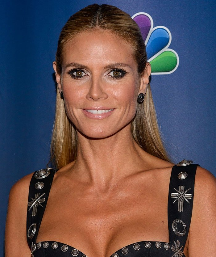 Heidi Klum sizzled in a Fausto Puglisi dress featuring an embellished bustier