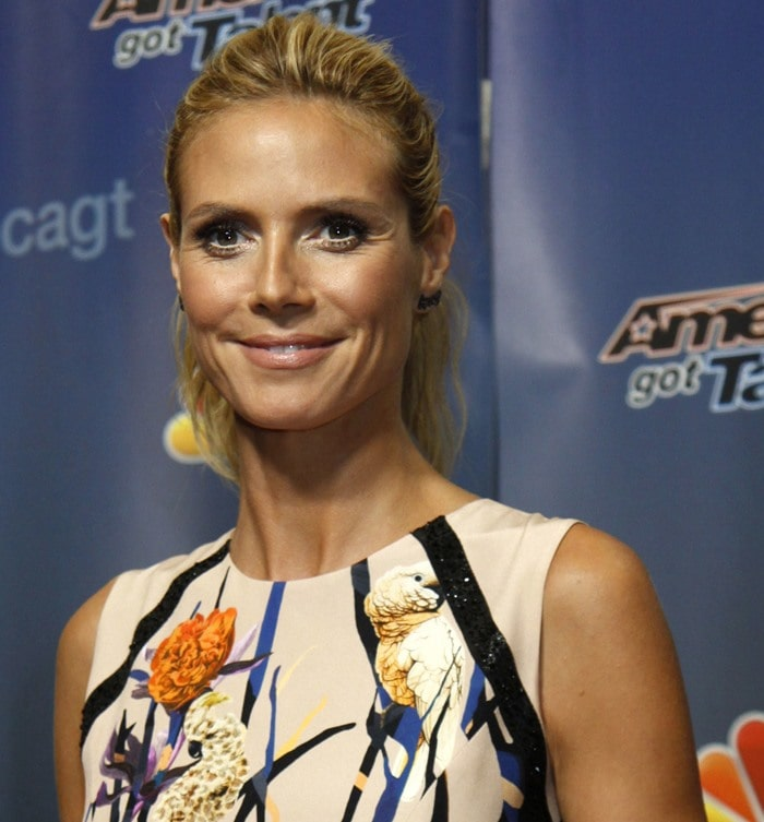 Heidi Klum suffered a fashion fail in a floral dress over satin-effect pants from the Loris Azzaro Fall 2015 Couture collection