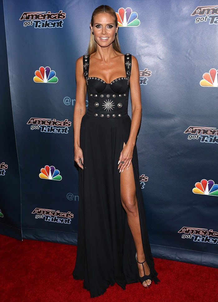 Heidi Klum showed off a leg in the racy thigh-high split dress