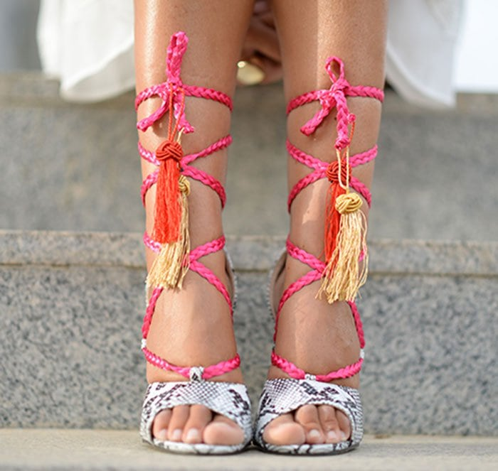 Helena's bright pink braided lace-up straps