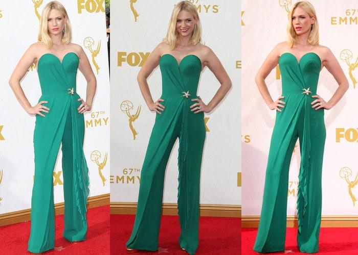January Jones wears an emerald green Ulyana Sergeenko jumpsuit on the red carpet of the Emmys