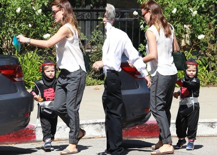 Jennifer Garner bringing her ninja son, Samuel Garner Affleck, out of the church and into her car