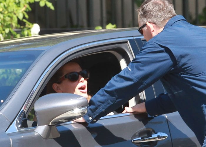 Jennifer Garner returns to her car after taking her children to the church in Pacific Palisades