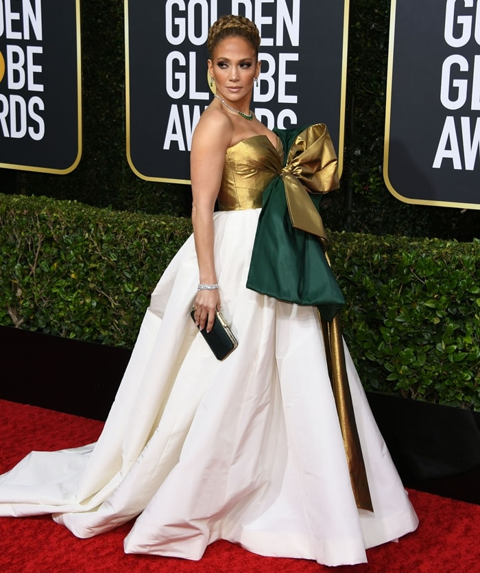 Jennifer Lopez donned a Valentino Haute Couture gown with a gigantic gold and emerald bow