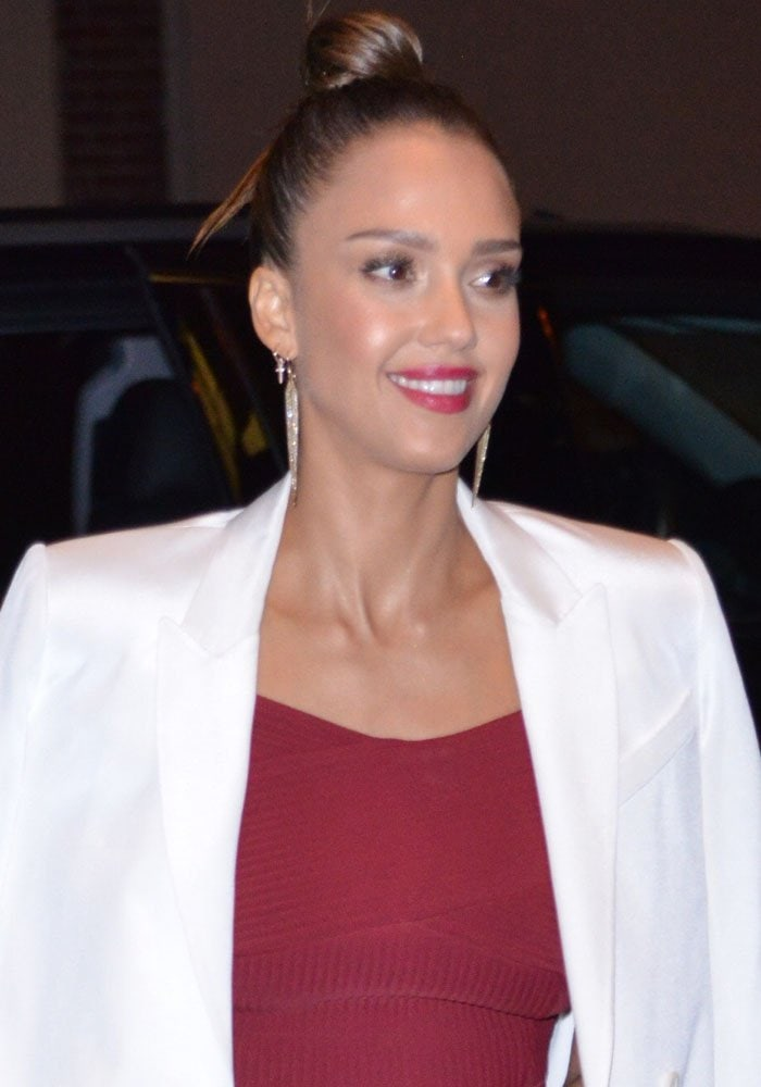 Jessica Alba wears her hair up as she returns to her hotel in New York