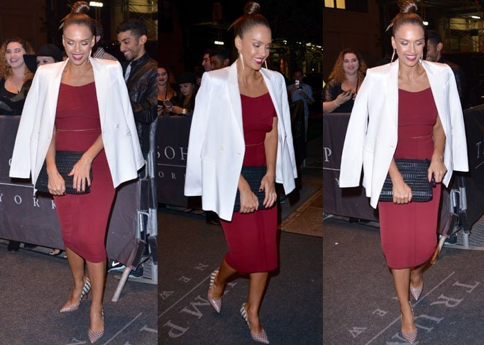 Jessica Alba wears a white blazer over top of a red Kempner dress