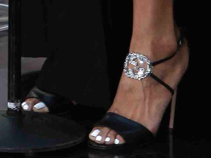 Jordin Sparks shows off her white pedicure and the sparkling Gucci logo on her sparkling GG logo sandals