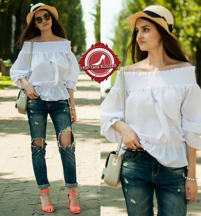 Karina in casual ripped jeans and a white breezy off-the-shoulder top