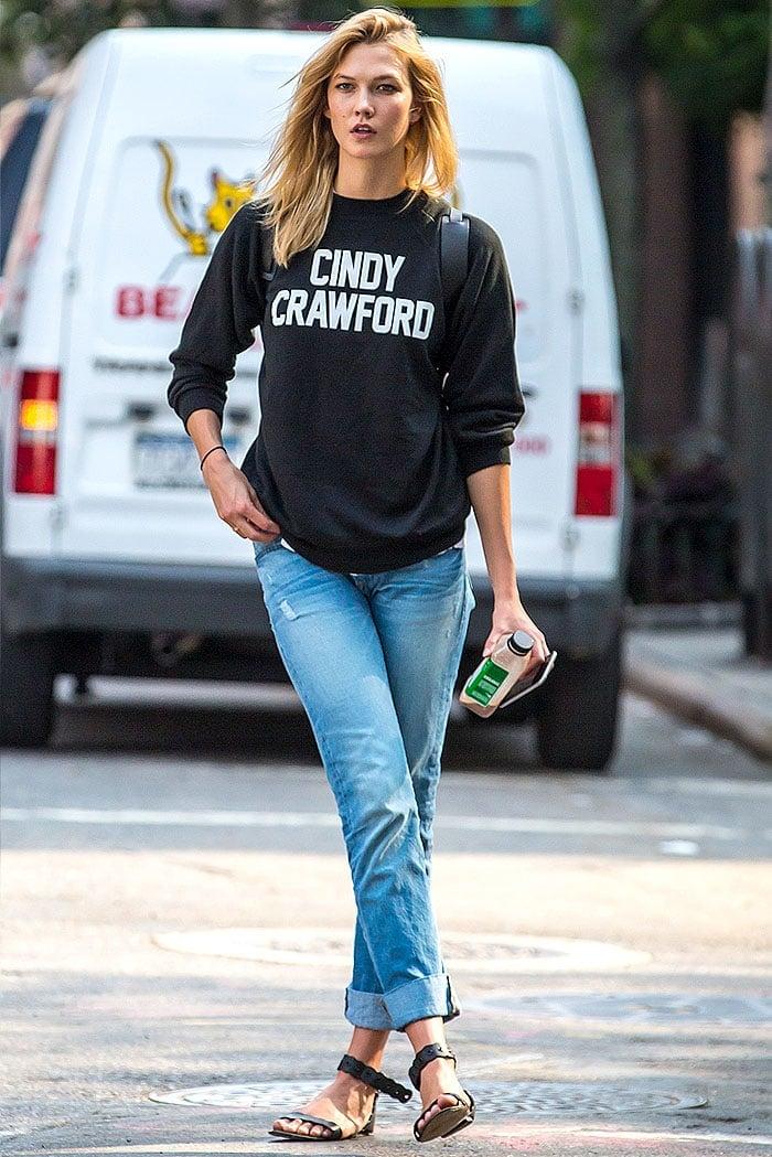 Karlie Kloss looks like a top modelas she waits for a taxi on a New York City street