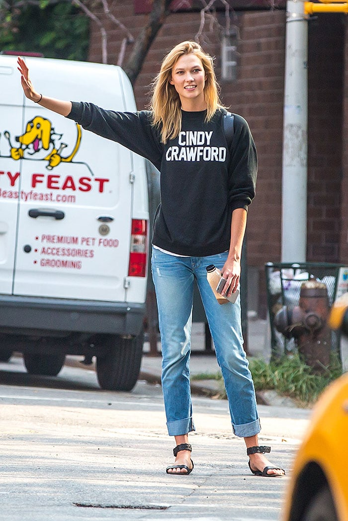 Karlie Kloss hails a cab for her first day of school at New York University