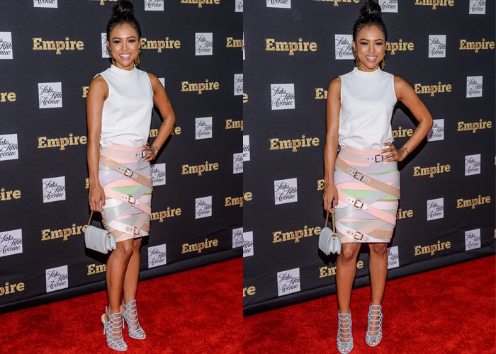 Karrueche Tran poses on the red carpet in a colorful belted Marina Hoermanseder skirt and a simple white blouse