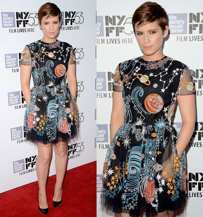 """Kate Mara shows off the pockets of her space-themed Valentino dress on the red carpet of the New York premiere of """"The Martian"""""""