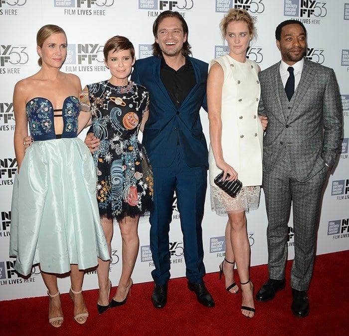 "Kristen Wiig, Kate Mara, Sebastian Stan, Mackenzie Davis and Chiwetel Ejiofor pose on the red carpet of the premiere of ""The Martian"""