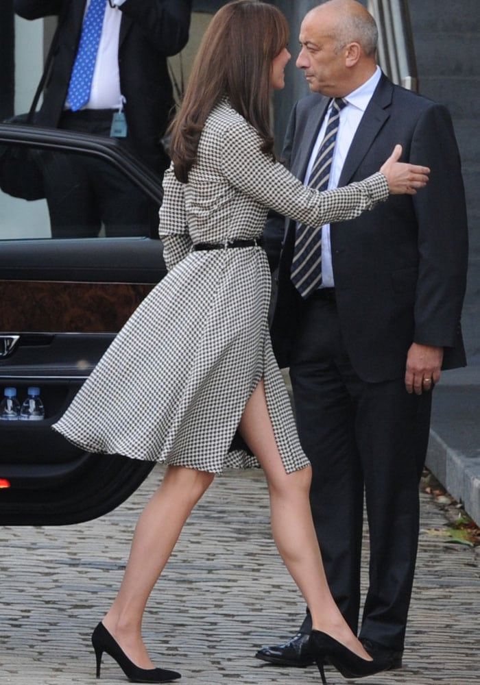 Kate Middleton returns to her royal duties in a houndstooth dress and a pair of black pumps