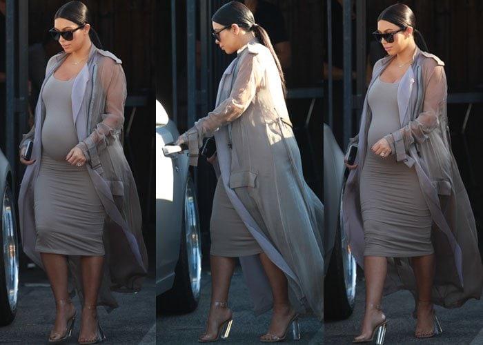 Kim Kardashian wears a Naked Wardrobe dress and a sheer Haider Ackermann trenchcoat out in Sherman Oaks