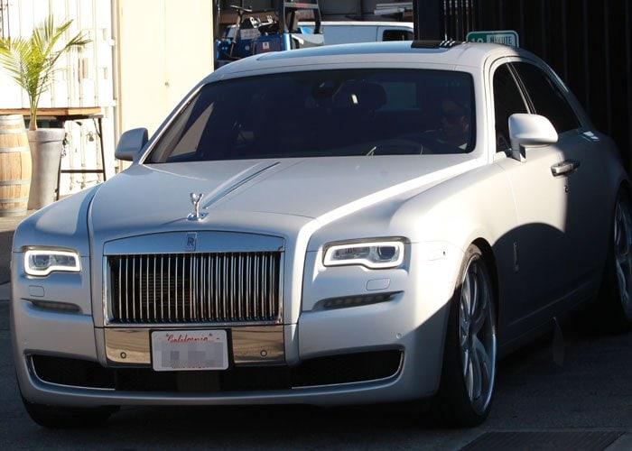 Kim Kardashian's Rolls Royce waits for Kim and Kanye