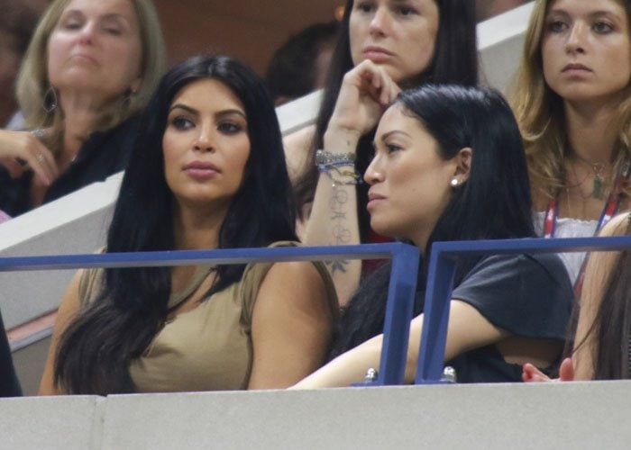 Kim Kardashian sits in the stands during the U.S. Open tennis match