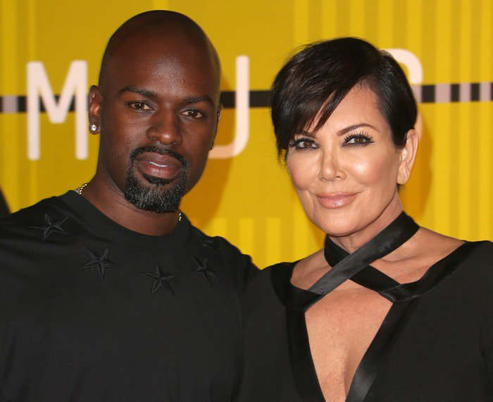 Kris Jenner poses with her boyfriend, Corey Gamble, at the MTV VMAs