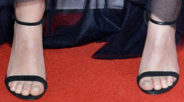Kristen Stewart shows off her unpolished toenails in a pair of Casadei heels
