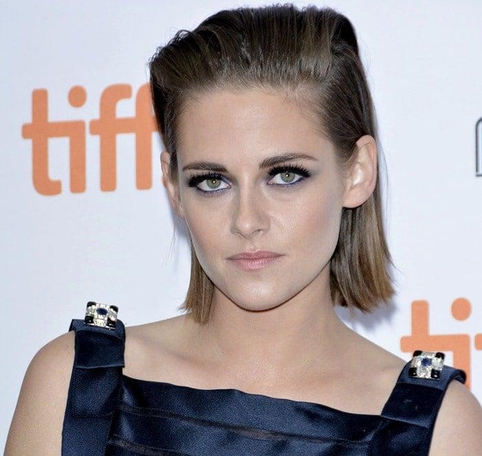 Kristen Stewart shows off her blue eyeshadow, false eyelashes and slicked-back hairstyle at the Toronto International Film Festival