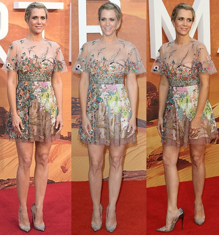 Kristen Wiig smiles and poses on the red carpet in a Valentino and Christian Louboutin combination