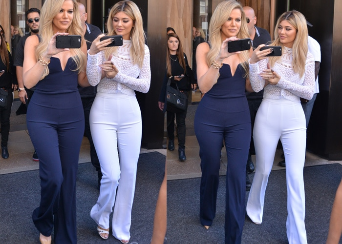 Khloé Kardashian and Kylie Jenner stroll out of their hotel in navy-and-white outfits while recording videos on their cellphones
