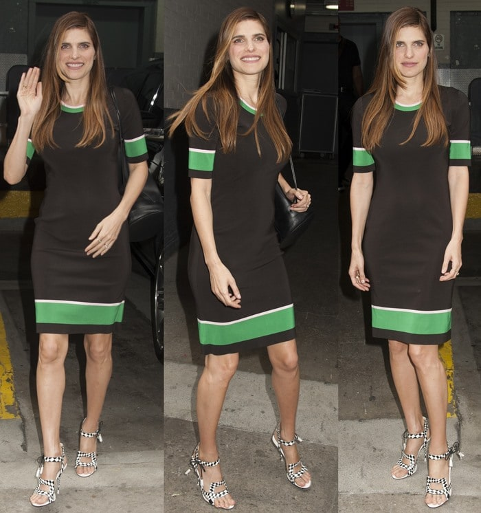 Lake Bell waves to fans and cameras as she shows off her Suno dress