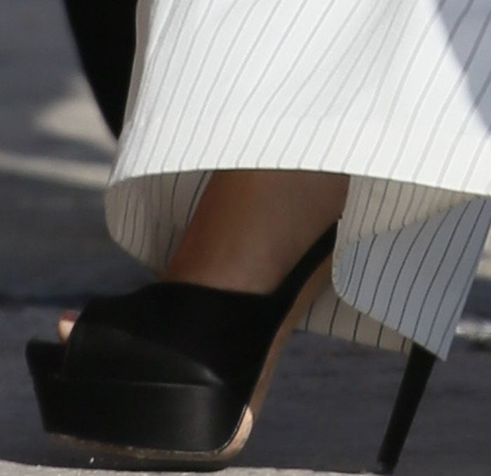 Lea Michelle completes her monochrome outfit with a pair of shoes from Brian Atwood on her feet