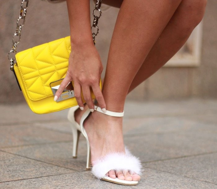Louise in furry white sandals