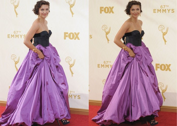 Maggie Gyllenhaal poses in front of a backdrop while wearing a stunning Oscar de la Renta dress