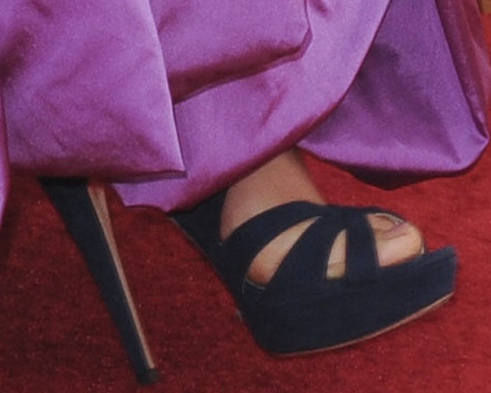 Maggie Gyllenhaal's Miu Miu platforms peek out from beneath the hem of her gown