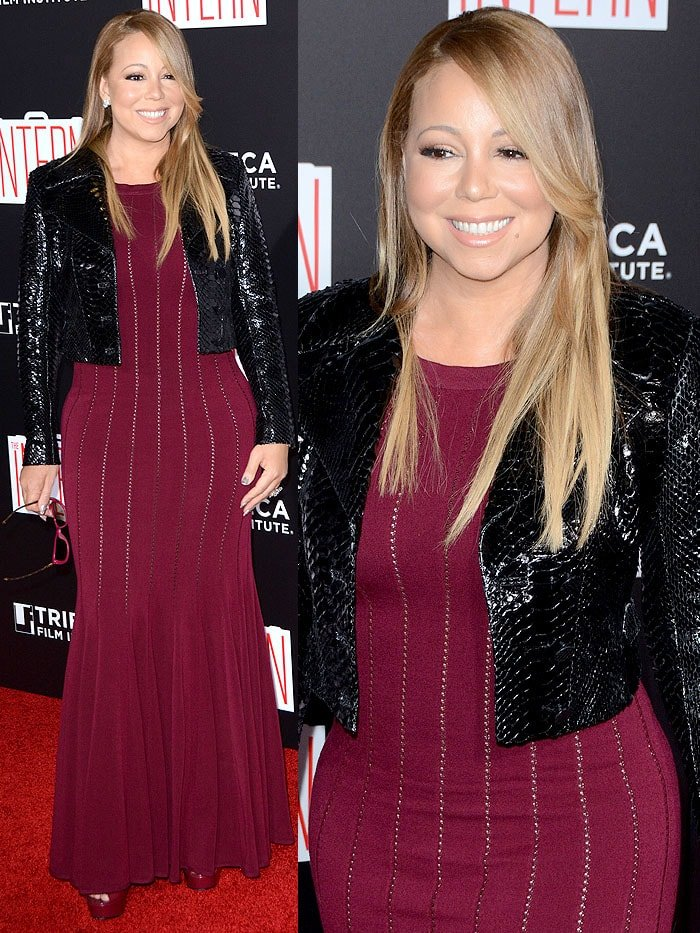 Mariah Carey pairs burgundy sunglasses with a burgundy Alaia gown, Alaia snake-textured jacket, and matching Gucci platform sandals