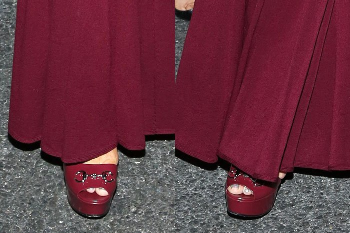 """Mariah Carey's Bordeaux Gucci """"Claudie"""" platform sandals peek out from beneath her matching gown"""