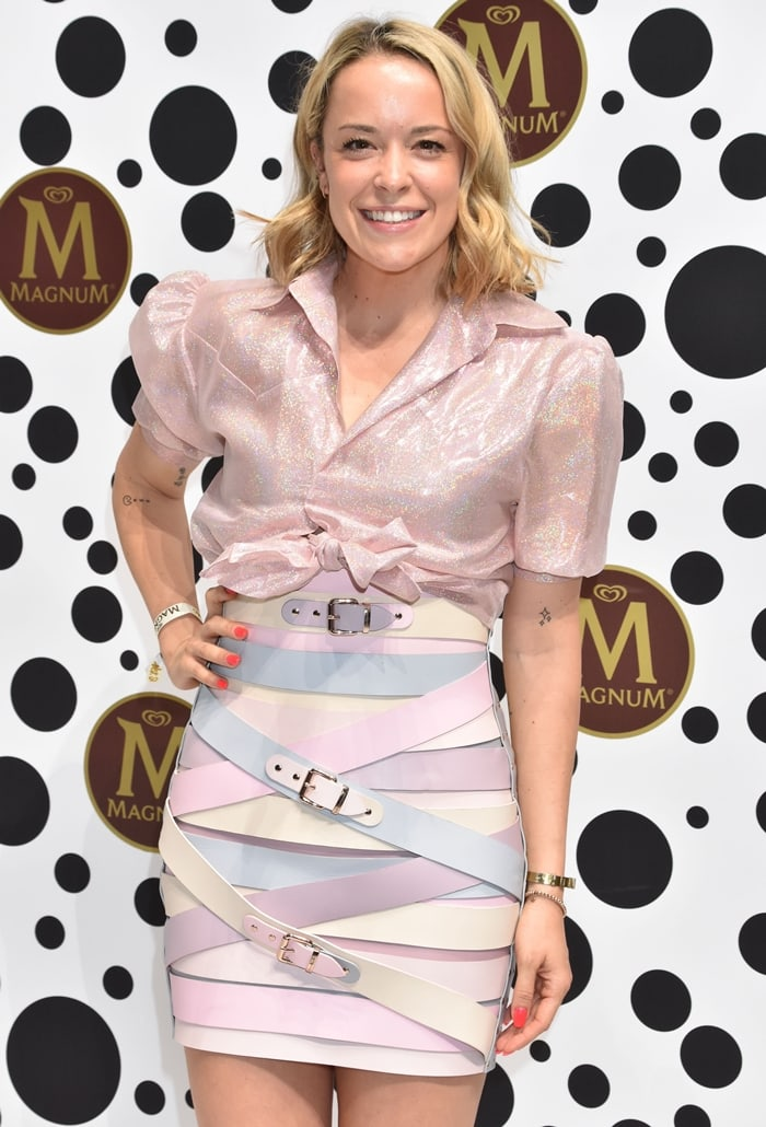 Fashion designer Marina Hoermanseder in a belted skirt at 30th anniversary Magnum ice cream and opening House of Play at Elisabehtkirche in Berlin