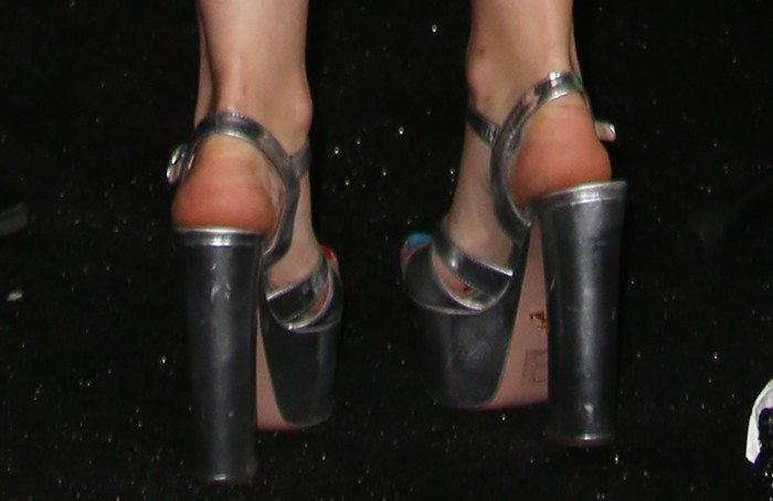 Miley Cyrus finishes off her eccentric look with a pair of metallic silver platform heels