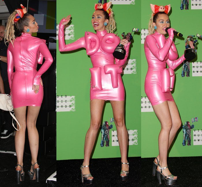 Miley Cyrus shows off her backside and her long slim legs as she poses in a pink inflatable dress