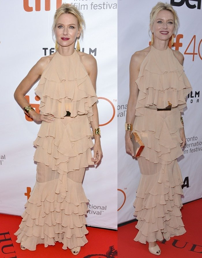 Naomi Watts drowns in beige-colored ruffles as she poses on the red carpet of the Toronto International Film Festival